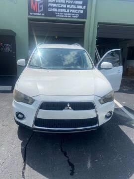 2011 Mitsubishi Outlander for sale at MLG Auto Group Inc. in Pompano Beach FL