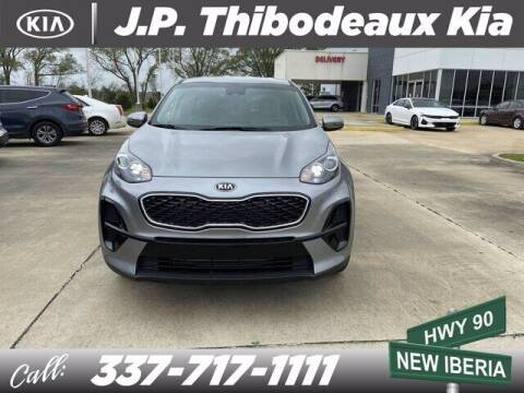 2021 Kia Sportage for sale at J P Thibodeaux Used Cars in New Iberia LA