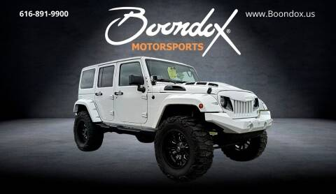 2016 Jeep Wrangler Unlimited for sale at Boondox Motorsports in Caledonia MI