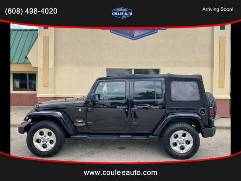 2013 Jeep Wrangler Unlimited for sale at Coulee Auto in La Crosse WI