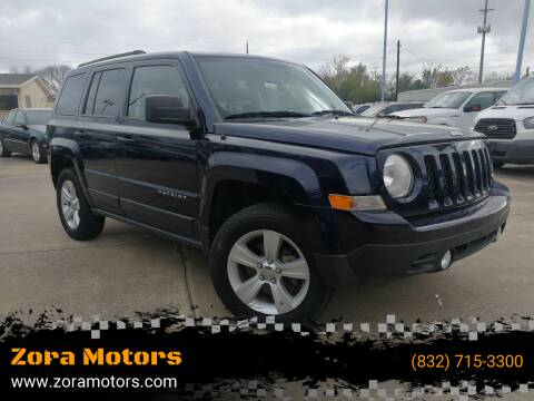2013 Jeep Patriot for sale at Zora Motors in Houston TX
