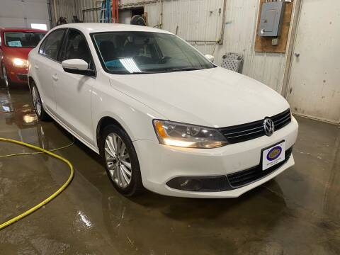 2011 Volkswagen Jetta for sale at BERG AUTO MALL & TRUCKING INC in Beresford SD