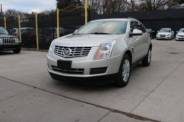 2014 Cadillac SRX for sale at F & M AUTO SALES in Detroit MI