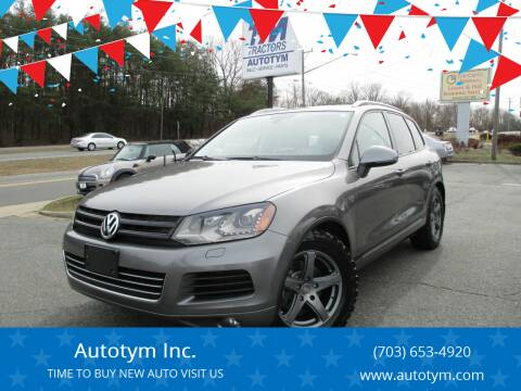 2012 Volkswagen Touareg for sale at AUTOTYM INC in Fredericksburg VA