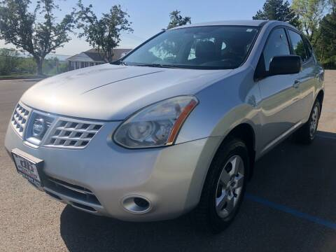 2009 Nissan Rogue for sale at DRIVE N BUY AUTO SALES in Ogden UT