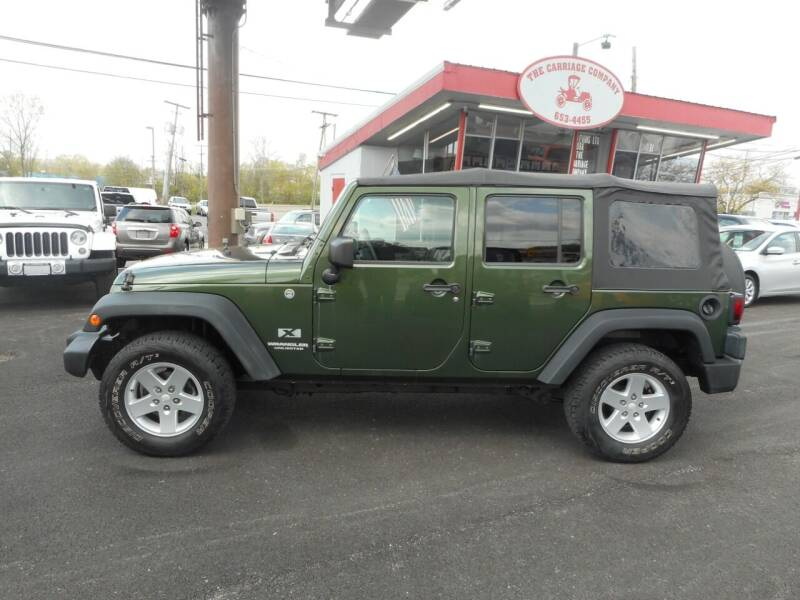 2009 Jeep Wrangler Unlimited for sale at The Carriage Company in Lancaster OH