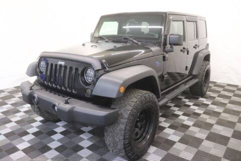 2011 Jeep Wrangler Unlimited for sale at AH Ride & Pride Auto Group in Akron OH
