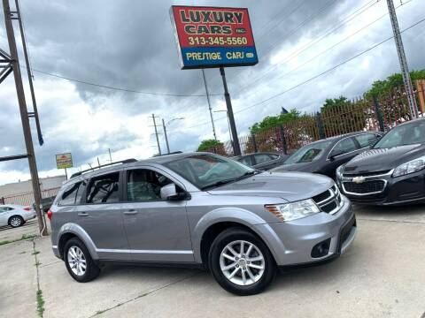2015 Dodge Journey for sale at Dymix Used Autos & Luxury Cars Inc in Detroit MI