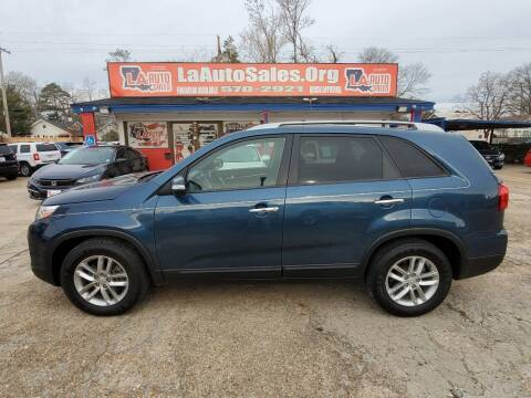 2014 Kia Sorento for sale at LA Auto Sales in Monroe LA
