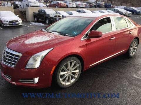 2014 Cadillac XTS for sale at J & M Automotive in Naugatuck CT