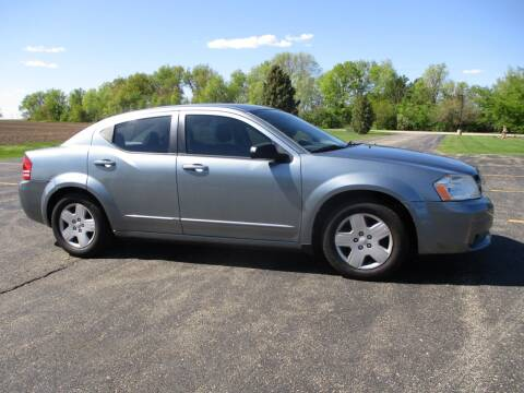 2010 Dodge Avenger for sale at Crossroads Used Cars Inc. in Tremont IL