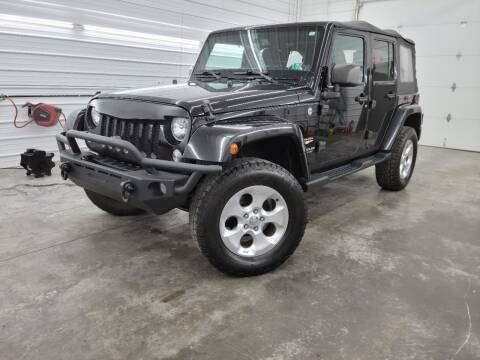 2014 Jeep Wrangler Unlimited for sale at CBI in Logan OH
