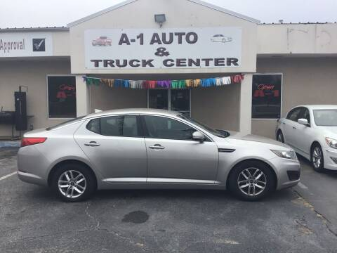 2011 Kia Optima for sale at A-1 AUTO AND TRUCK CENTER in Memphis TN