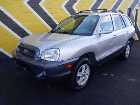 2004 Hyundai Santa Fe for sale at MIRACLE AUTO SALES in Cranston RI