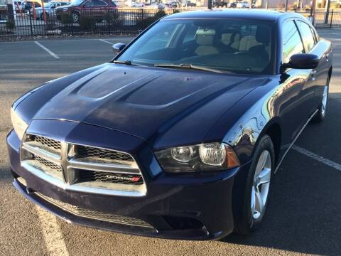 2014 Dodge Charger for sale at MAGIC AUTO SALES in Little Ferry NJ