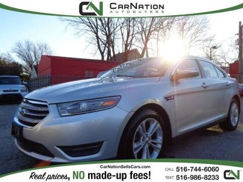 2013 Ford Taurus for sale at CarNation AUTOBUYERS, Inc. in Rockville Centre NY