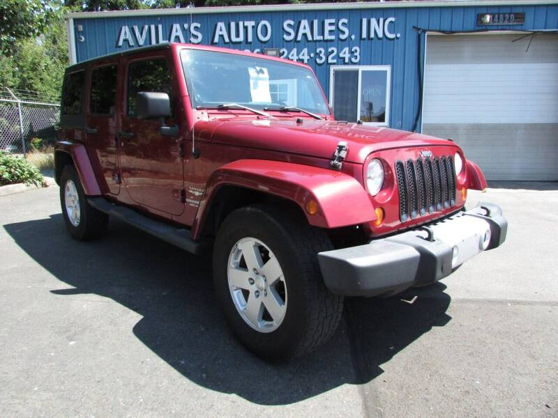 2012 Jeep Wrangler Unlimited for sale at Avilas Auto Sales Inc in Burien WA
