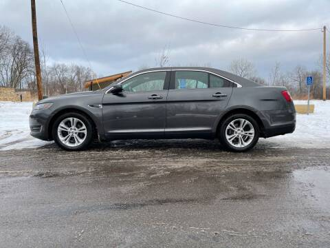 2016 Ford Taurus for sale at You Win Auto in Metro MN
