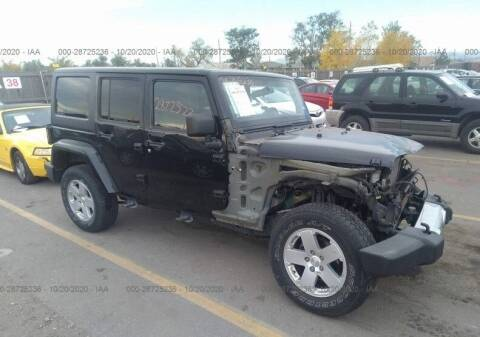 2012 Jeep Wrangler Unlimited for sale at STS Automotive in Denver CO