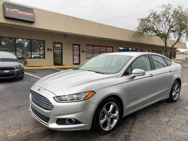 2013 Ford Fusion Hybrid for sale at Top Garage Commercial LLC in Ocoee FL