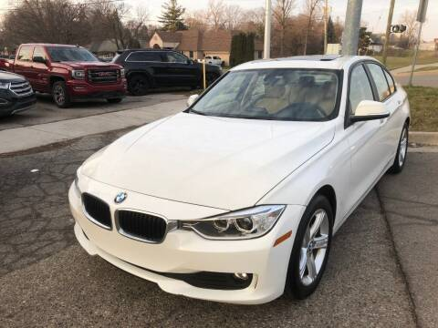 2013 BMW 3 Series for sale at One Price Auto in Mount Clemens MI