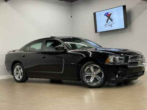 2013 Dodge Charger for sale at TX Auto Group in Houston TX
