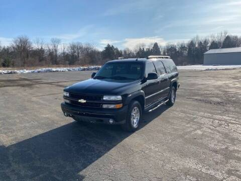 2005 Chevrolet Suburban for sale at Caruzin Motors in Flint MI