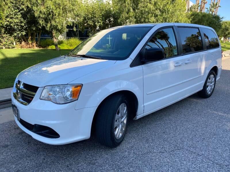 2014 Dodge Grand Caravan for sale at Donada  Group Inc in Arleta CA
