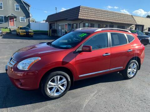 2013 Nissan Rogue for sale at MAGNUM MOTORS in Reedsville PA