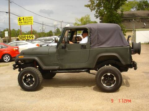 1995 Jeep Wrangler for sale at A-1 Auto Sales in Conroe TX