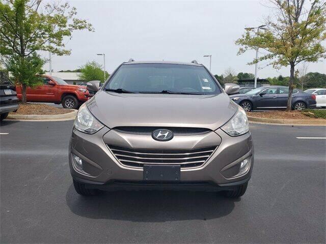 2013 Hyundai Tucson for sale at Lou Sobh Kia in Cumming GA