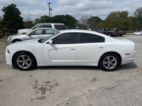 2013 Dodge Charger for sale at TAVERN MOTORS in Laurens SC