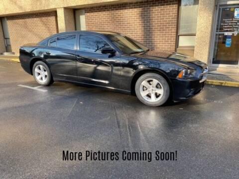2014 Dodge Charger for sale at Warner Motors in East Orange NJ