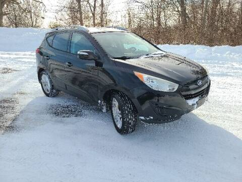 2012 Hyundai Tucson for sale at BETTER BUYS AUTO INC in East Windsor CT