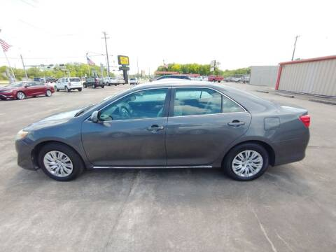 2012 Toyota Camry for sale at BIG 7 USED CARS INC in League City TX