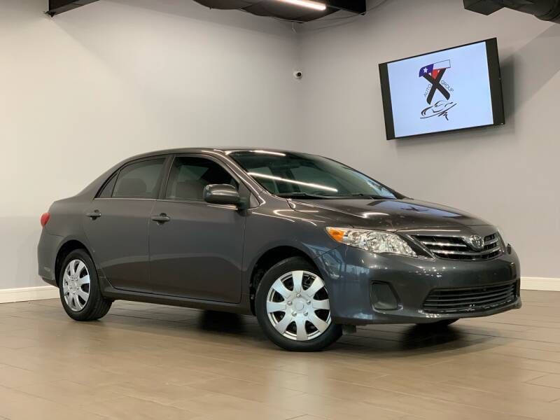 2013 Toyota Corolla for sale at TX Auto Group in Houston TX