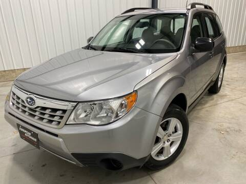 2011 Subaru Forester for sale at EUROPEAN AUTOHAUS, LLC in Holland MI
