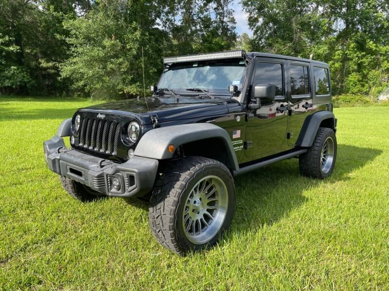 2015 Jeep Wrangler Unlimited for sale at AUTO WOODLANDS in Magnolia TX