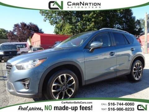 2016 Mazda CX-5 for sale at CarNation AUTOBUYERS Inc. in Rockville Centre NY