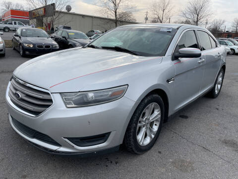 2014 Ford Taurus for sale at Diana Rico LLC in Dalton GA