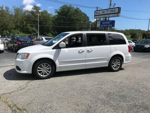 2014 Dodge Grand Caravan for sale at M G Motors in Johnston RI