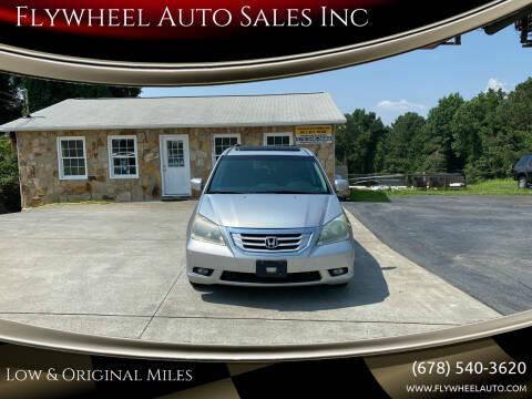 2010 Honda Odyssey for sale at Flywheel Auto Sales Inc in Woodstock GA