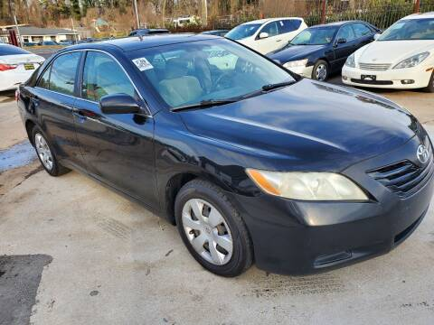 2009 Toyota Camry for sale at Palmer Automobile Sales in Decatur GA