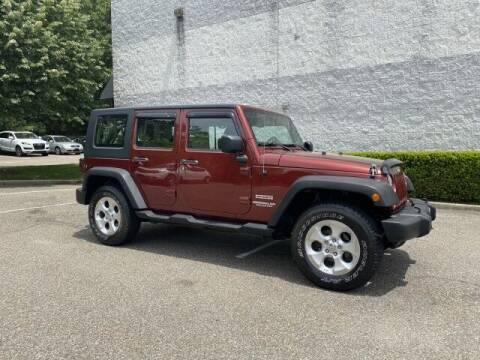 2010 Jeep Wrangler Unlimited for sale at Select Auto in Smithtown NY