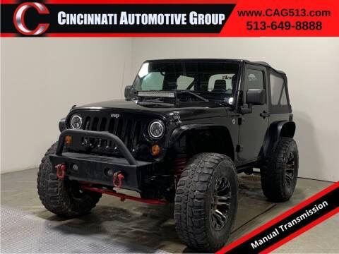 2013 Jeep Wrangler for sale at Cincinnati Automotive Group in Lebanon OH