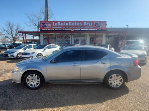 2014 Dodge Avenger for sale at LA Auto Sales in Monroe LA