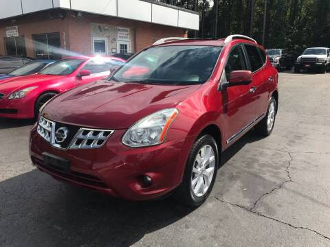 2012 Nissan Rogue for sale at Magic Motors Inc. in Snellville GA