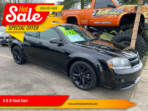 2014 Dodge Avenger for sale at A & R Used Cars in Clayton NJ