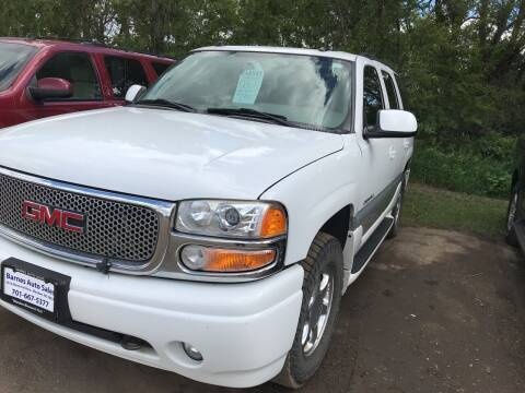2005 GMC Yukon for sale at BARNES AUTO SALES in Mandan ND