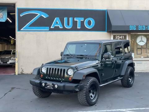 2011 Jeep Wrangler Unlimited for sale at Z Auto in Sacramento CA